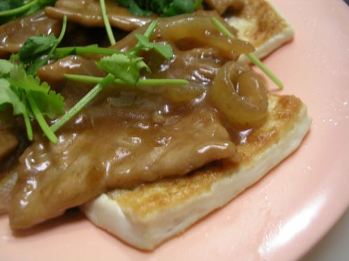 Pan-seared silken tofu with pork and onion gravy